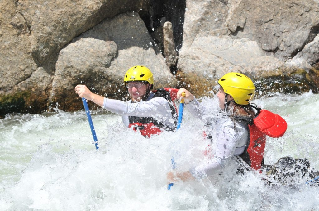 two people paddling in rapids