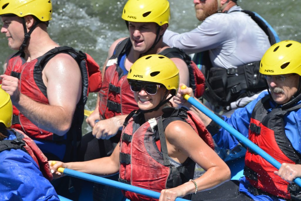 smiling with sunglasses in raft