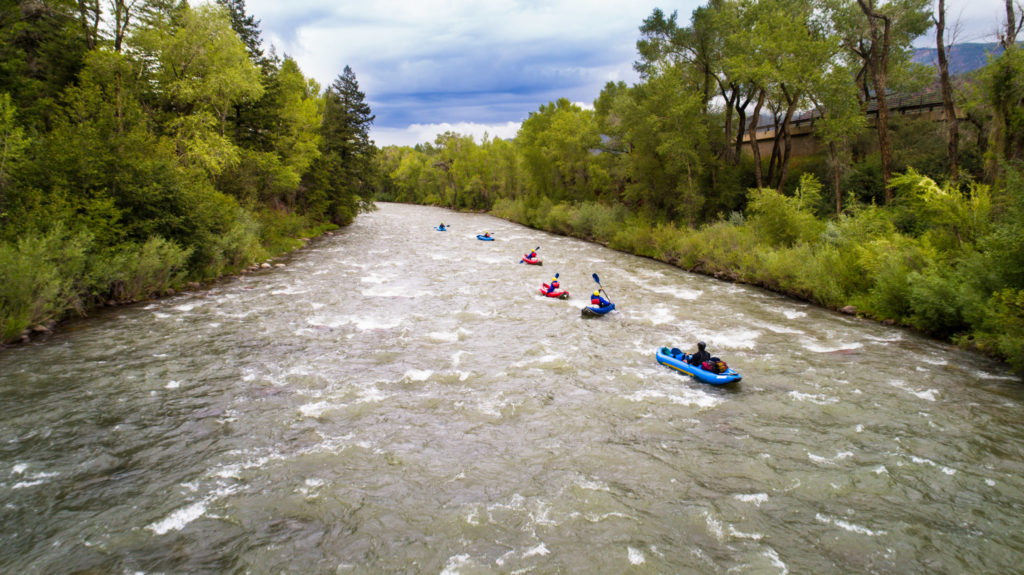 several kayaks going down river