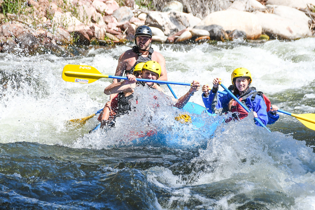 group in rapids on raft