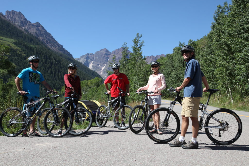 group resting by bikes