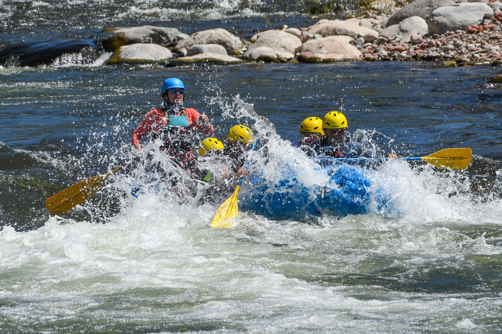 group getting splashed in raft