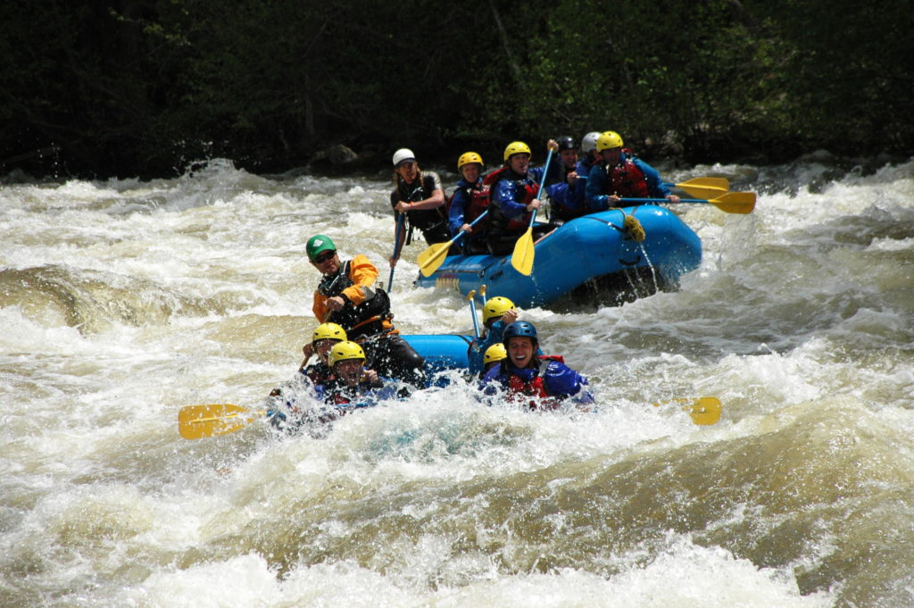 multiple rafts going down rapids