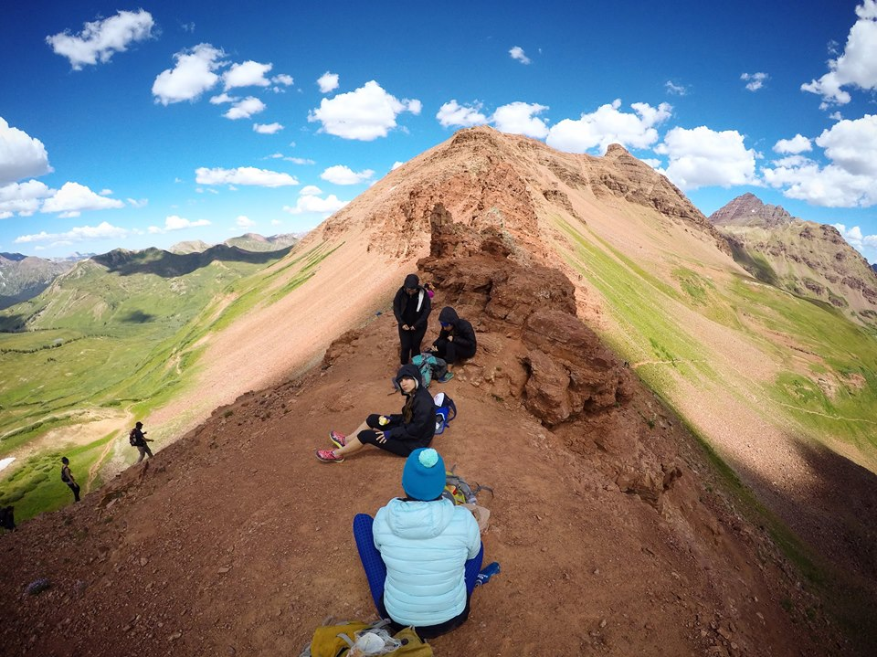 peoples resting on mountain